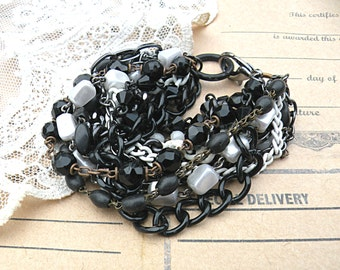 black white multi chain bracelet layer tangle assemblage upcycled vintage rosary parts cottage chic spectator