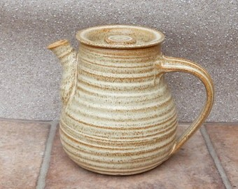 Teapot hand thrown in stoneware pottery ceramic