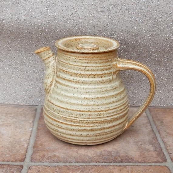 Teapot hand thrown in stoneware pottery ceramic