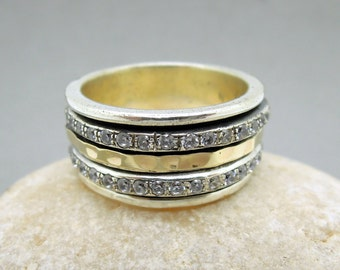 Spinner ring with silver, gold & Zircon spinners