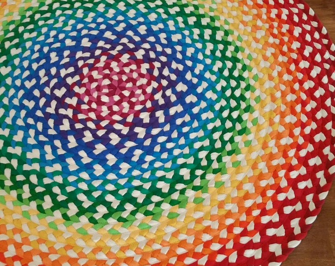 rainbow braided rug created from new and recycled t shirts