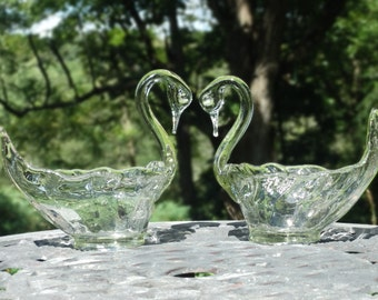 A pair of vintage, hand blown swan dishes.