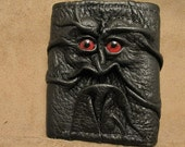 Grichels leather tri-fold wallet - black with red carousel horse eyes