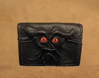 Grichels leather card wallet - black with poppy orange slit pupil reptile eyes