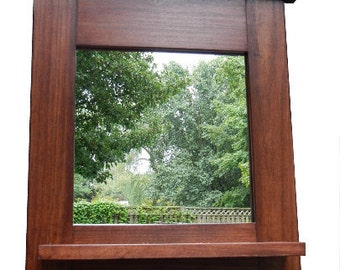 Dillon entry mirror made with solid hardwood   3 key hooks, a shelf, and a quality finish 19 x 21 highx 4 deep