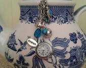 Blue and Silver  Alice Tea Party Inspired Dream  Watch Hanger Clip for Bag or Belt made from New and  Reclaimed Findings