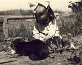 Little Girl With RIBBON In Her Hair Plays in the Dirt While Her CATS LOOK On Photo Postcard Circa 1910