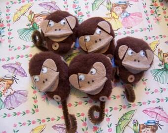 little brown monkey pom poms