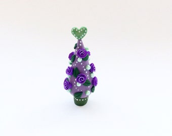 Miniature Christmas tree with purple roses and dark green leaves handmade from polymer clay
