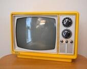 Portable Yellow Television by Quasar 1975