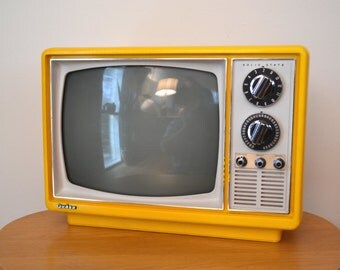 Portable Yellow Television by Quasar 1975