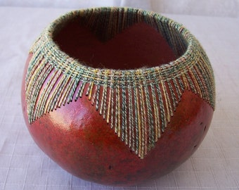 Small rust and green stitched gourd bowl. 1904.