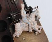 Vintage lead toy, figurine man riding a horse. Horseman