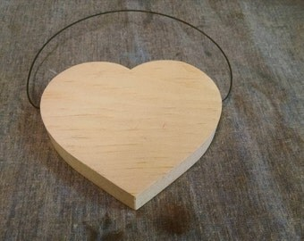 Blank wooden heart plaque with wire hanger. 4 inch wide, 3.75 inch tall, 3/4 inch thick. Unfinished wood. Lot of 10.