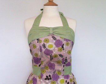 Retro apron with bow, dark purple floral on a purple fabric, fully lined.