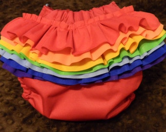 SassyCloth one size pocket diaper with red PUL outer and removable rainbow ruffles. Ready to ship.