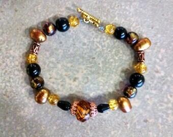 Brown black lampwork glass, copper, gold bracelet