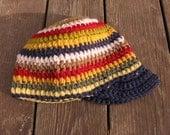Striped cap with brim, crocheted.