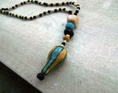L'Intrépide - Clay hand painted pendant with semi-precious, glass and plastic beads. The Balloons Collection