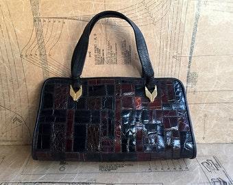 1980s Big Leather Turtle Handbag by Jane Shilton. Black, Burgundy Plums & Browns