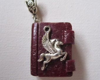 Maroon Book with Pegasus Pendant