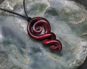 Maori koru & Celtic twisting vine~ symbolising eternal bonding. Hand carved naturally stained bone