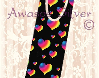 Metal bookmark with high quality printed original images. Rainbow hearts with black background on high quality metal bookmark.