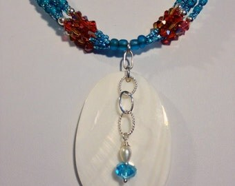 Contemporary Turquoise Color Seed Bead and Swarovski Crystal Multistrand Necklace With Mother-Of-Pearl Pendant