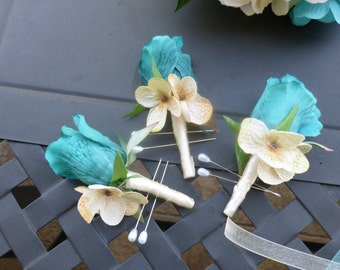 1 turquoise rose boutonniere with champagne hydrangea accent