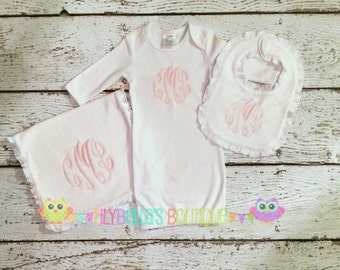 Monogrammed gown, bib, and burp cloth