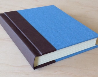 Sky blue and faux brown leather hardbound journal or sketchbook with blank pages