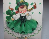 Adorable unused Hallmark 1950's-60's mid century St. Patrick's Day themed bridge tally cute little girl wearing green clover decorated dress