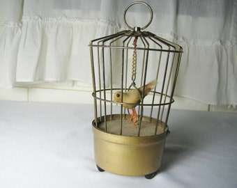Vtg battery op. chirping bird in cage