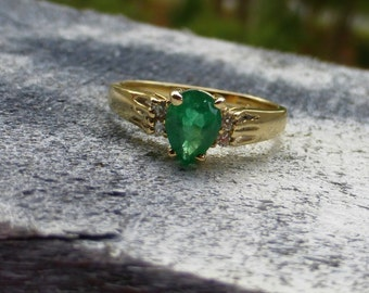 14k Vivid Green Natural Colombian Emerald and diamond ring.