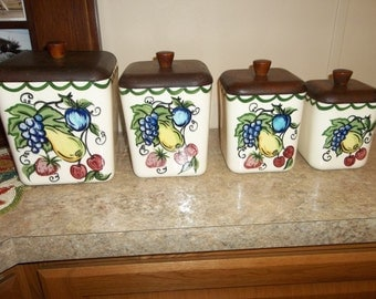 Primitive Mid Cenury Hand Painted Ceramic Canister Set...Wood lids...Good Condition...