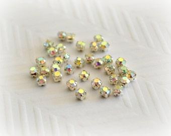 2mm Sew on AB Rhinestones.  Silver Colored Settings. 50 pcs