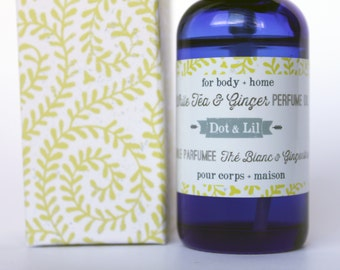 white tea & ginger perfume oil in blue glass apothecary-style bottle