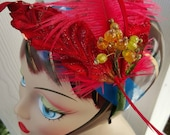 Red Christmas fascinator with cruelty free ostrich feather red rooster feathers and millinery supplies