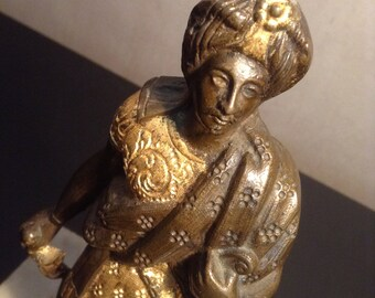 Vintage gilded bronze statue middle eastern man on marble base wearing robes and turban