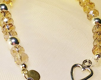 Crystals, 8 mm gold ovals, 8mm silver beads, heart toggle clasp, 8 inch, #B1022