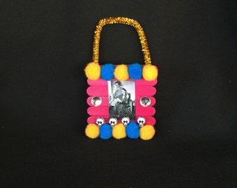 Pink Orange and Blue Frida Kahlo and Diego Rivera Pom Pom Wooden Popsicle Stick Ornament