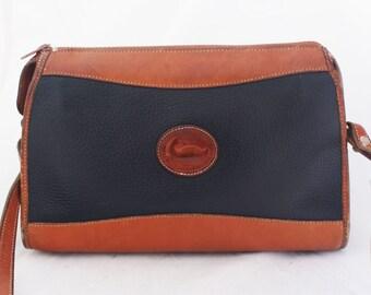Purse - Medium Dooney Bourke All Weather Leather Satchel Handbag over the shoulder with strap