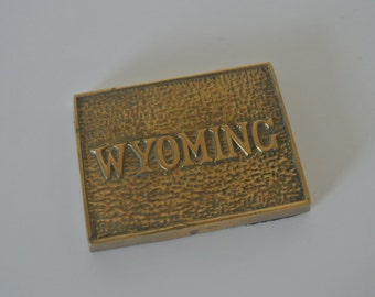 Vintage Brass Wyoming Paperweight