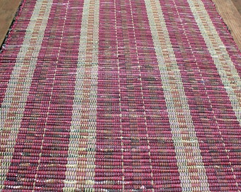 Wine red and brown striped rug