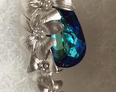 Cascading Flowers Surrounding Bermuda Blue Swarvoski Crystal, Wedding, Prom, Anniversary