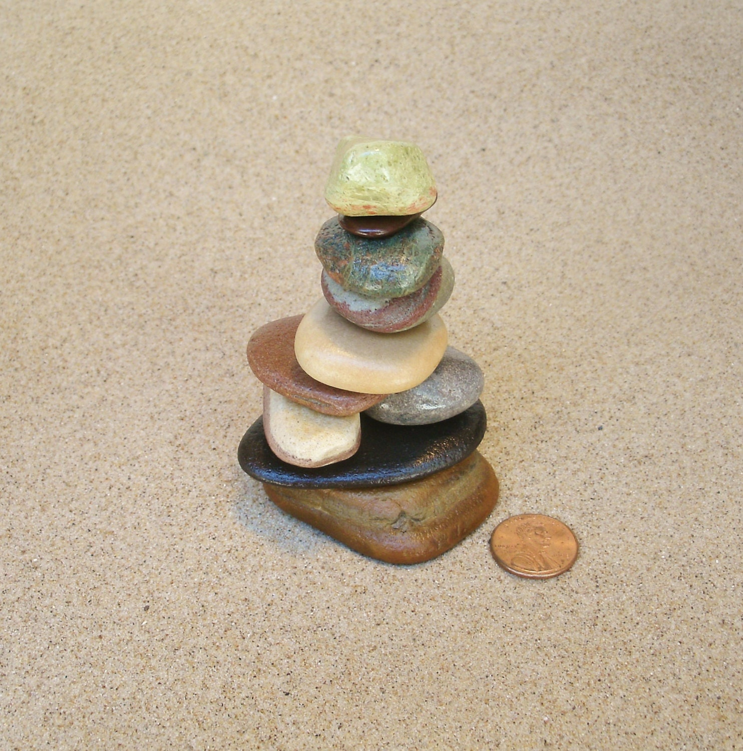 Lake michigan stacked beach stone cairn sculpture