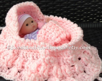 crochet cradle purse in solid pink with oh so cute doll in purple stripe pjs with bottle blanket and pillow