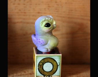 Owlguin , resin cast figure , Green-malve colorway