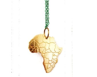Minimal Africa necklace on enameled green chain.       Africa love travel necklace.      Minimal modern jewelry with a charitable donation
