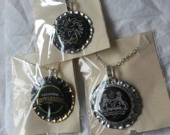 three bottlecap pendant necklaces
